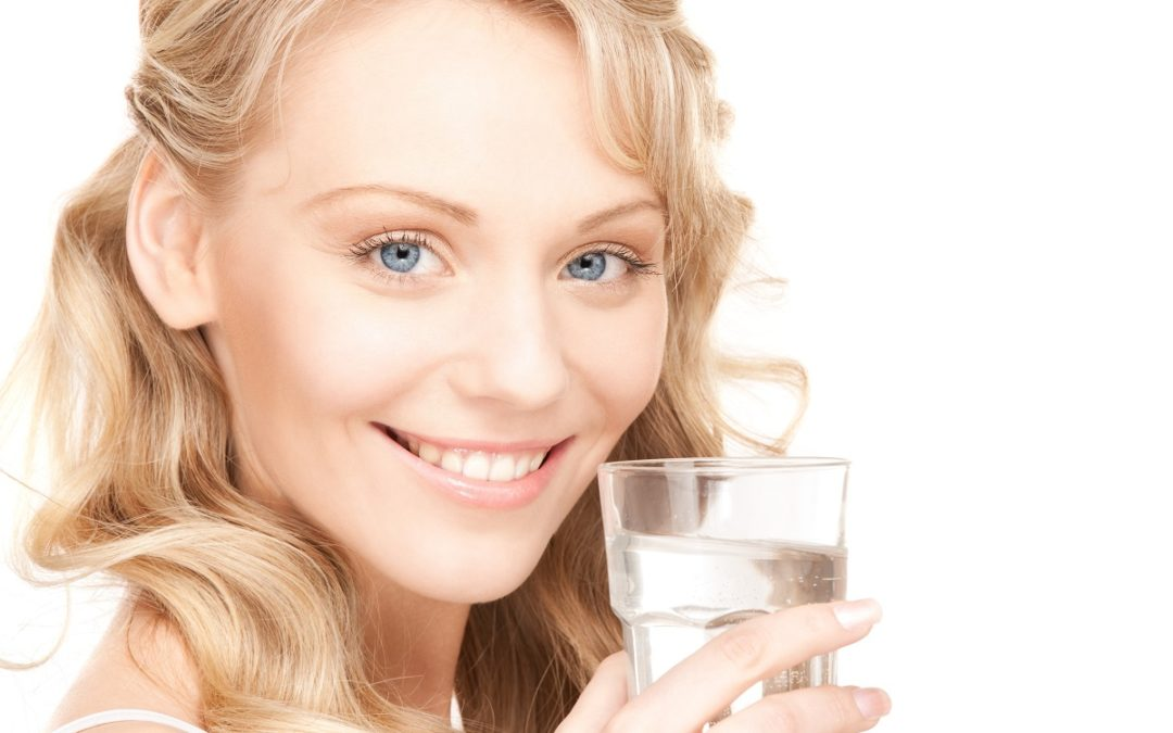 Why Your Newport Beach Dentist Recommends That You Drink More Water